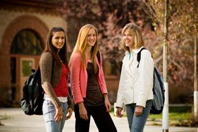 Three girls on college campus.