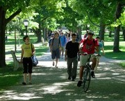 Students riding bikes and walking on campus.